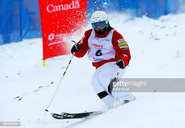Patrick Deneen of the US competes during the men's moguls finals at the FIS Freestyle Ski World Cup January 4 2014 in Calgary Alberta Canada