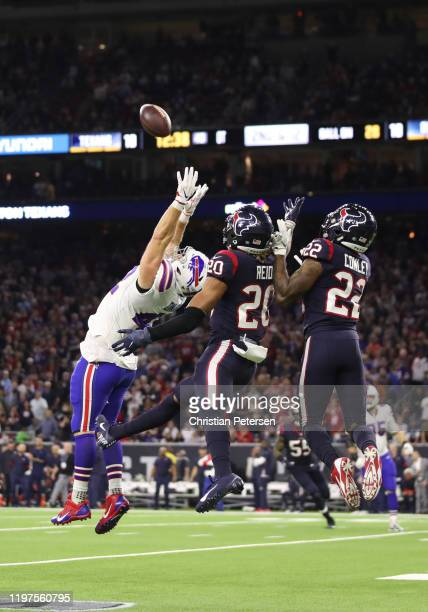 Patrick DiMarco of the Buffalo Bills misses a pass attempt under pressure from Justin Reid and Gareon Conley of the Houston Texans during overtime of...