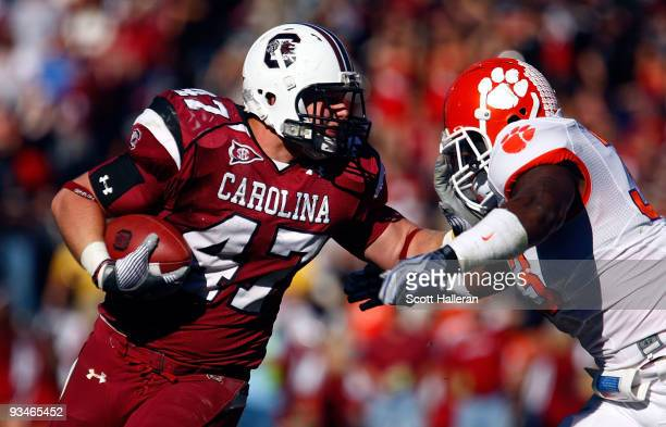 Patrick DiMarco of the South Carolina Gamecocks fights off the tackle of Kavell Conner of the Clemson Tigers at WilliamsBrice Stadium on November 28...