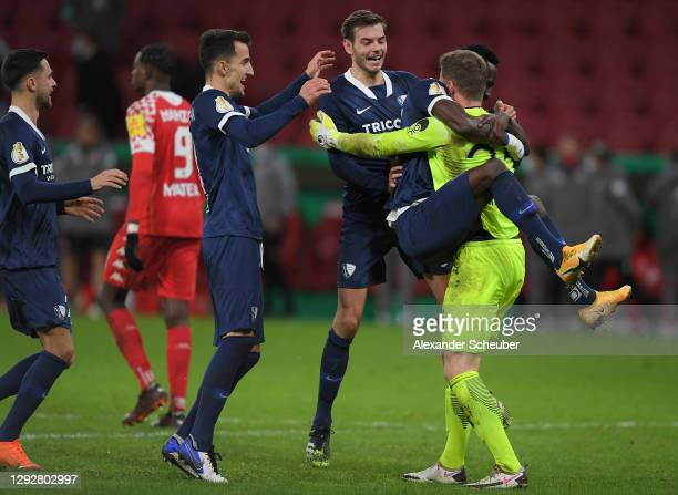 Patrick Drewes of VfL Bochum celebrates victory with team mates Maxim Leitsch and Armel Bella-Kotchap after a penalty shoot out in the DFB Cup second...
