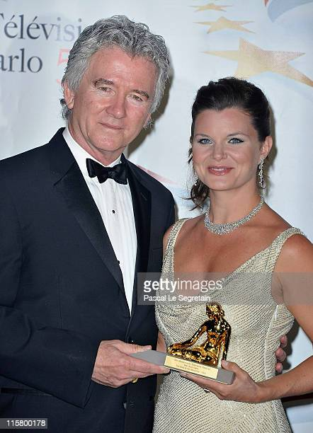 Patrick Duffy and Heather Tom pose with their Golden Nymphe award after the closing ceremony of the 2011 Monte Carlo Television Festival held at the...