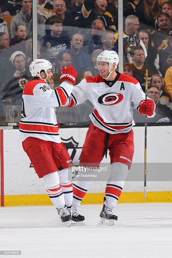 Patrick Dwyer #39 and Jordan Staal #11 of the Carolina Hurricanes celebrate a goal against the Boston Bruins at the TD Garden on November 23, 2013 in Boston, Massachusetts.