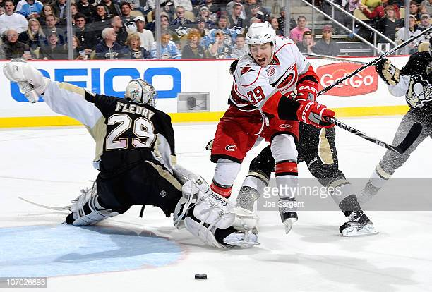 Patrick Dwyer of the Carolina Hurricanes gets tripped up by MarcAndre Fleury of the Pittsburgh Penguins on November 19 2010 at Consol Energy Center...
