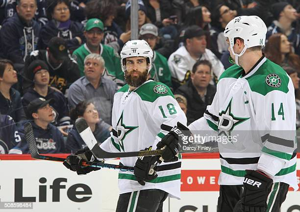 Patrick Eaves and Jamie Benn of the Dallas Stars discuss strategy during a first period stoppage in play against the Winnipeg Jets at the MTS Centre...