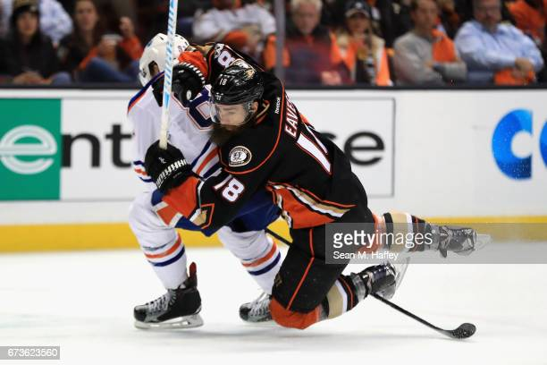 Patrick Eaves of the Anaheim Ducks collides with Matthew Benning of the Edmonton Oilers in the third period in Game One of the Western Conference...
