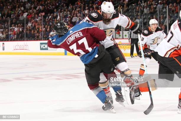 Patrick Eaves of the Anaheim Ducks fights for position against JT Compher of the Colorado Avalanche at the Pepsi Center on October 13 2017 in Denver...