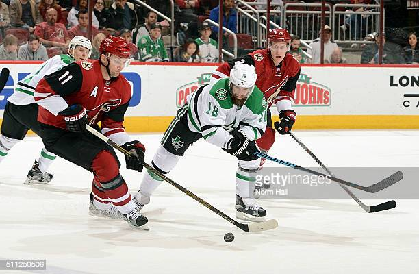 Patrick Eaves of the Dallas Stars and Martin Hanzal of the Arizona Coyotes battle for a loose puck during the third period at Gila River Arena on...
