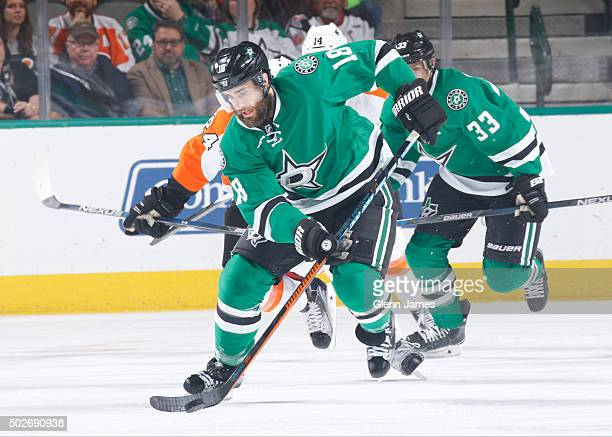 Patrick Eaves of the Dallas Stars handles the puck against the Philadelphia Flyers at the American Airlines Center on December 11 2015 in Dallas Texas