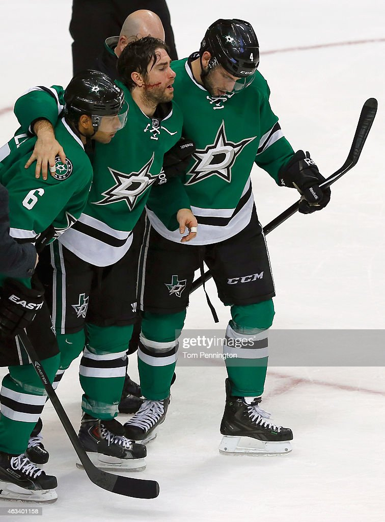 Patrick Eaves #18 of the Dallas Stars is assisted off the ice by Trevor Daley #6 of the Dallas Stars and Jason Demers #4 of the Dallas Stars after being hit by a puck in the third period against the Florida Panthers at American Airlines Center on February 13, 2015 in Dallas, Texas.
