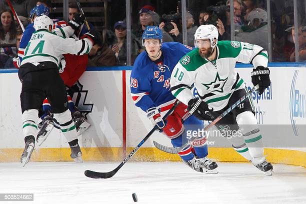 Patrick Eaves of the Dallas Stars skates for the puck against Jesper Fast of the New York Rangers at Madison Square Garden on January 5 2016 in New...