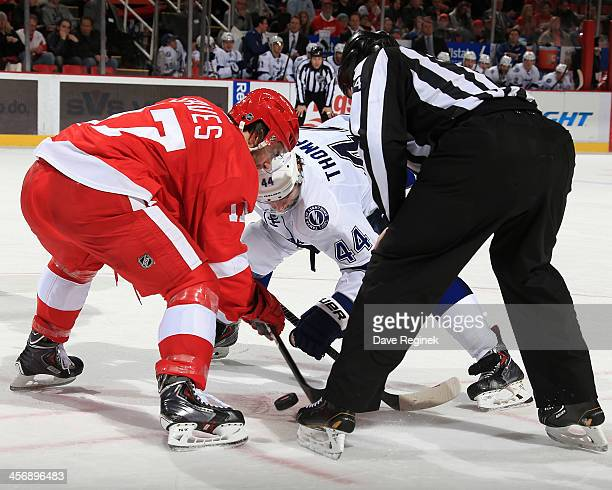 Patrick Eaves of the Detroit Red Wings and Nate Thompson of the Tampa Bay Lightning faceoff during an NHL game at Joe Louis Arena on December 15 2013...