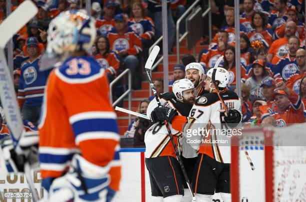 Patrick Eaves Ryan Getzlaf and Rickard Rakell of the Anaheim Ducks celebrate a goal against goalie Cam Talbot of the Edmonton Oilers in Game Three of...