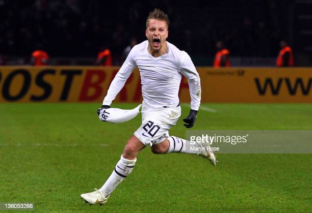 Patrick Ebert of Berlin celebrates after he scores his team's 3rd goal during the DFB Cup round of sixteen match between Hertha BSC Berlin and 1. FC...