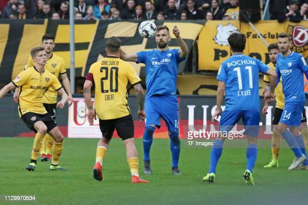 Patrick Ebert of Dynamo Dresden and Lukas Hinterseer of VfL Bochum 1848 battle for the ball during the second Bundesliga match between Dynamo Dresden...