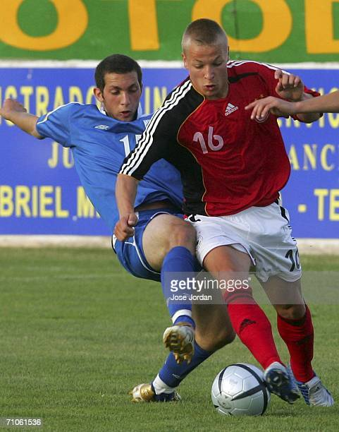 Patrick Ebert of Germany vies for the ball with Andreas Avraam of Cyprus during the UEFA Under 19 qualification round between Germany and Cyprus at...