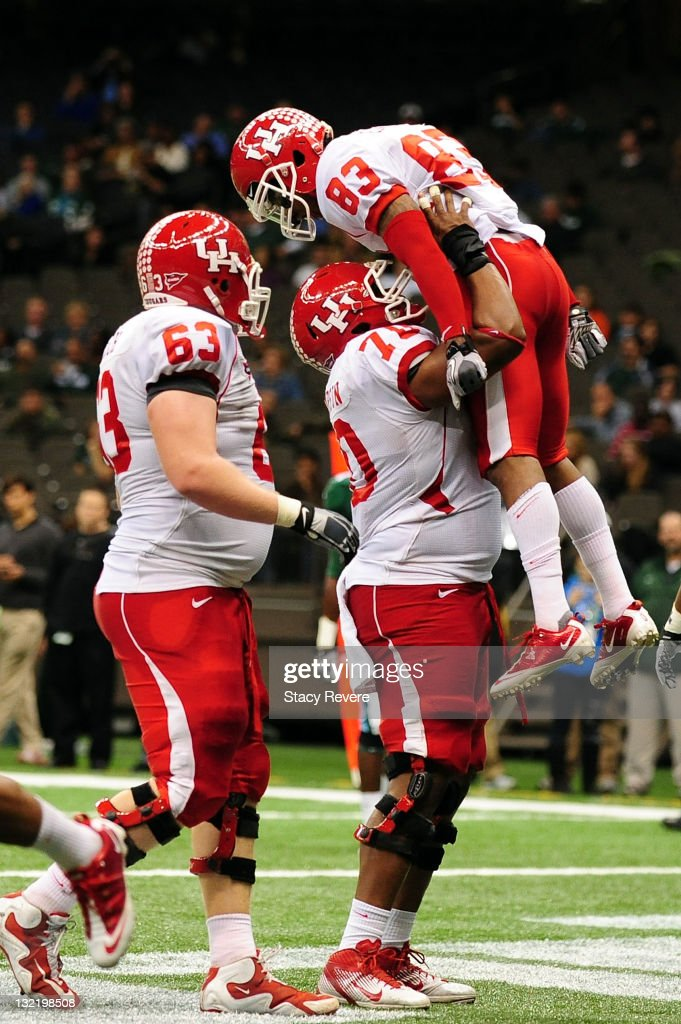 Patrick Edwards #83 of the University of Houston Cougars celebrates a touchdown against the Tulane Green Wave with teammates during a game being held at the Mercedes-Benz Superdome on November 10, 2011 in New Orleans, Louisiana.