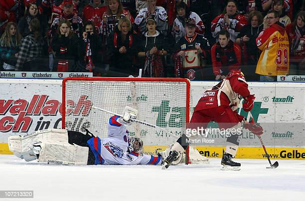 Patrick Ehelechner goaltender of Nuernberg saves the penalty of Thomas Dolak of Hannover during the DEL match between Hannover Scorpions and Thomas...