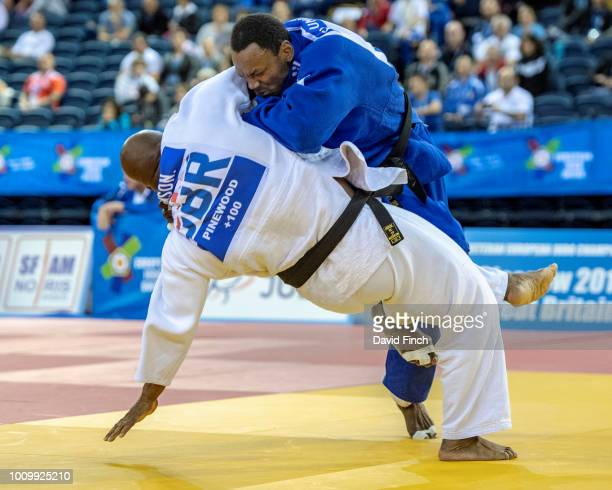 Patrick Eloumou Boteba of France throws Samson Omonua of Great Britain for an ippon to win the M3 o100kg gold medal during day 2 of the 2018 Glasgow...