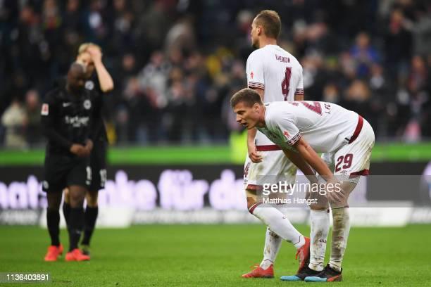 Patrick Erras and Ewerton of Nurnberg look dejected after the Bundesliga match between Eintracht Frankfurt and 1 FC Nuernberg at CommerzbankArena on...