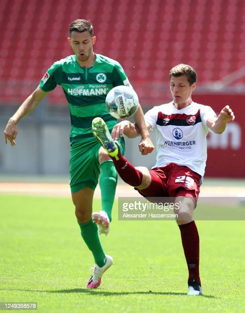 Patrick Erras of 1. FC Nuernberg is challenged by Branimir Hrgota of SpVgg Greuther Fuerth during the Second Bundesliga match between 1. FC Nürnberg...