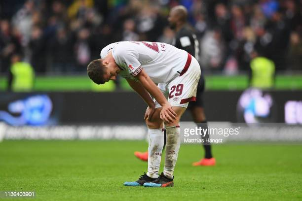 Patrick Erras of Nurnberg looks dejected after the Bundesliga match between Eintracht Frankfurt and 1 FC Nuernberg at CommerzbankArena on March 17...