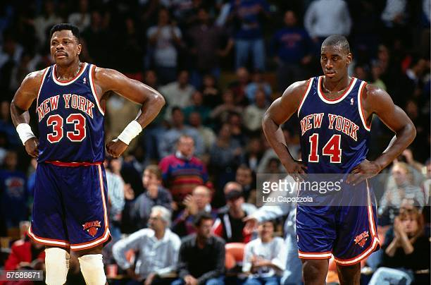 Patrick Ewing and Anthony Mason of the New York Knicks look on during a game against the Cleveland Cavaliers at the Richfield Coliseum on November 7,...