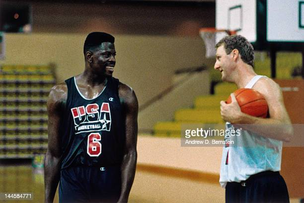 Patrick Ewing and Larry Bird of the United States National Team talk during a practice in June 1992 in La Jolla California NOTE TO USER User...