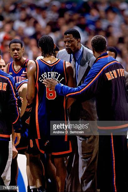 Patrick Ewing and Latrell Sprewell of the New York Knicks talk during Game One of the 1999 NBA Finals played at the Alamodome on June 16 1999 in San...