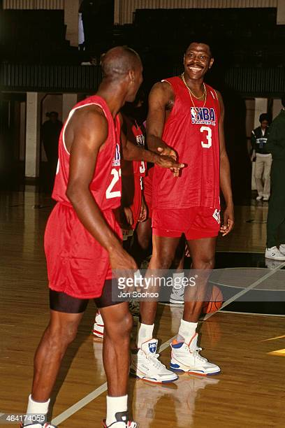 Patrick Ewing and Michael Jordan of the Eastern Conference AllStars high hive each other during NBA AllStar Practice as part of the 1991 All Star...