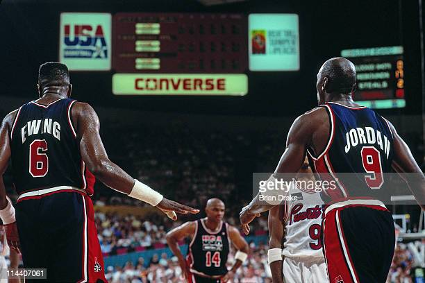 Patrick Ewing and Michael Jordan of the United States Senior Men's team look on against Puerto Rico during the 1992 Basketball Tournament of Americas...