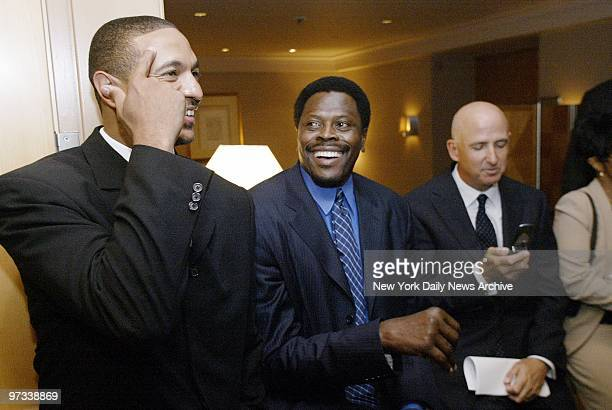 Patrick Ewing jokes with the Denver Nuggets' Mark Jackson after Ewing announced his retirement at a news conference at the Four Seasons Hotel ending...