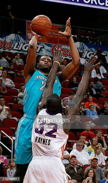 Patrick Ewing Jr #22 of the Sioux Falls Skyforce shoots over Michael Haynes of the Iowa Energy during their game March 18 2011 at the Wells Fargo...