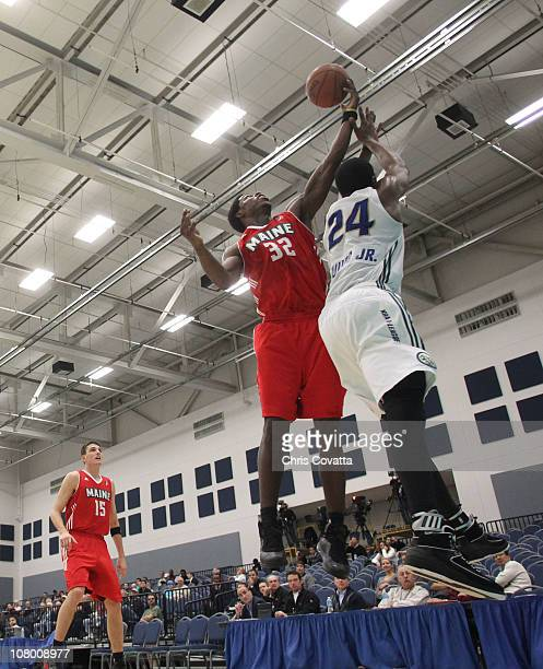 Patrick Ewing Jr #24 of the Reno Big Horns shoots the ball over DeShawn Sims of the Maine Red Claws during the 2011 NBA DLeague Showcase on January...