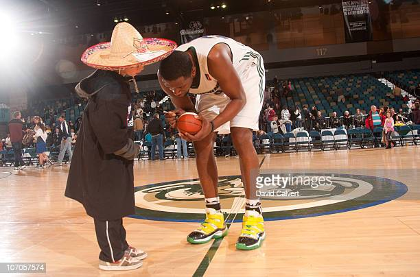 Patrick Ewing Jr #24 of the Reno Bighorns signs an autograph for a young fan follwong the game against the Utah Flash on November 21 2010 at the Reno...