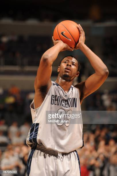 Patrick Ewing Jr #33 of the Georgetown Hoyas takes a foul shot during a basketball game against the Fordham Rams at Verizon Center on December 31...