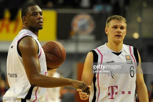 Patrick Ewing Jr and Benas Veikalas of Bonn shake hands during the Beko Basketball match between FC Bayern Muenchen and Telekom Baskets Bonn at...