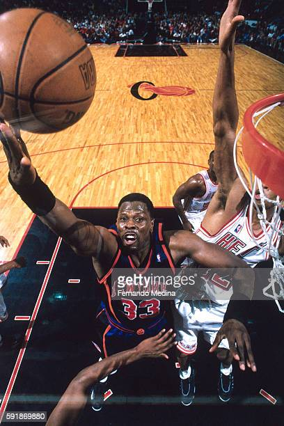 Patrick Ewing of th New York Knicks shoots the ball during Round One of the NBA Eastern Conference Playoffs against the Miami Heat on May 16 1999 at...