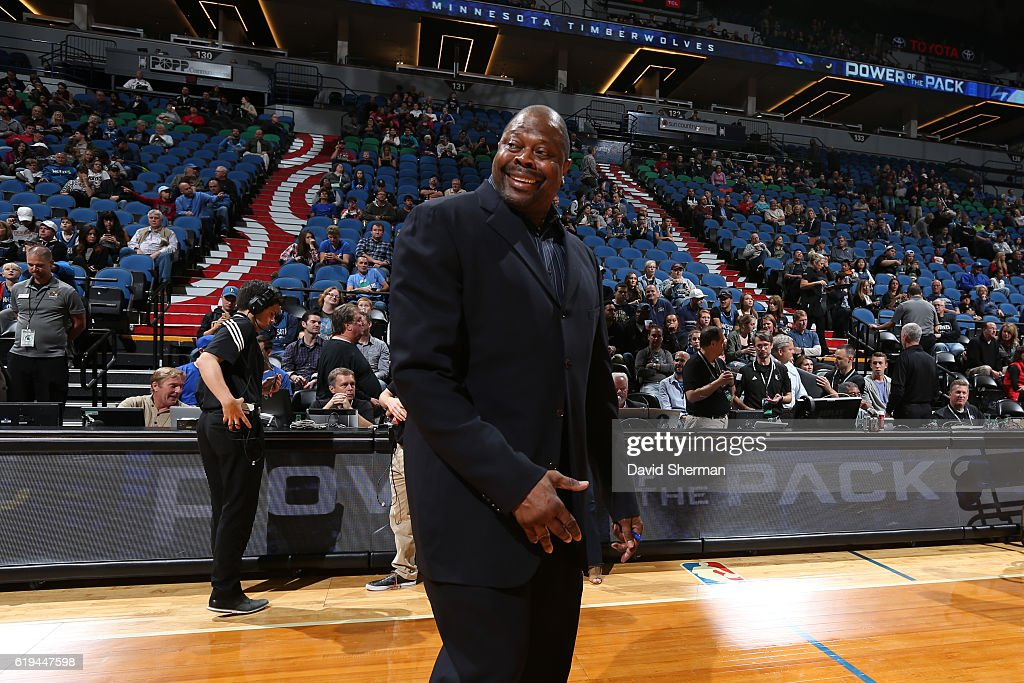 Patrick Ewing of the Charlotte Hornets smiles on court before an NBA preseason game against the Minnesota Timberwolves on October 21, 2016 at the Target Center in Minneapolis, Minnesota.