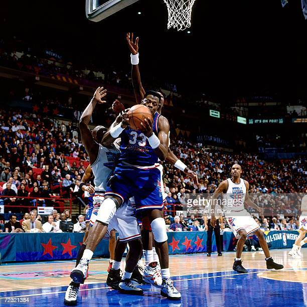 2231af789 Patrick Ewing of the Eastern Conference All Stars grabs the rebound against  Hakeem Olajuwon of the