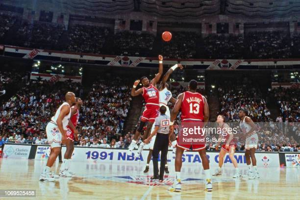 Patrick Ewing of the Eastern Conference AllStars jumps the opening tip against David Robinson of the Western Conference AllStars during the 1991 NBA...