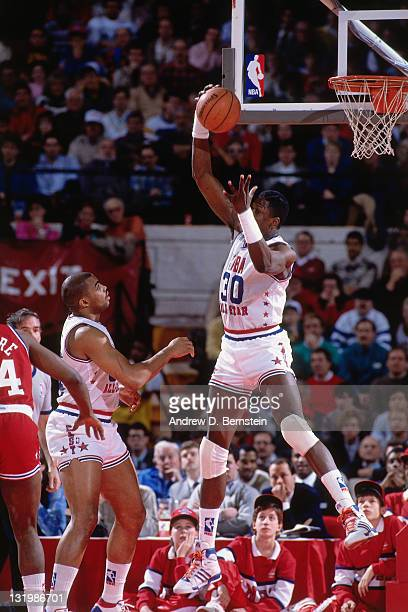 Patrick Ewing of the Eastern Conference rebounds the ball during the 1988 NBA AllStar Game on February 7 1988 at the Chicago Stadium in Chicago...