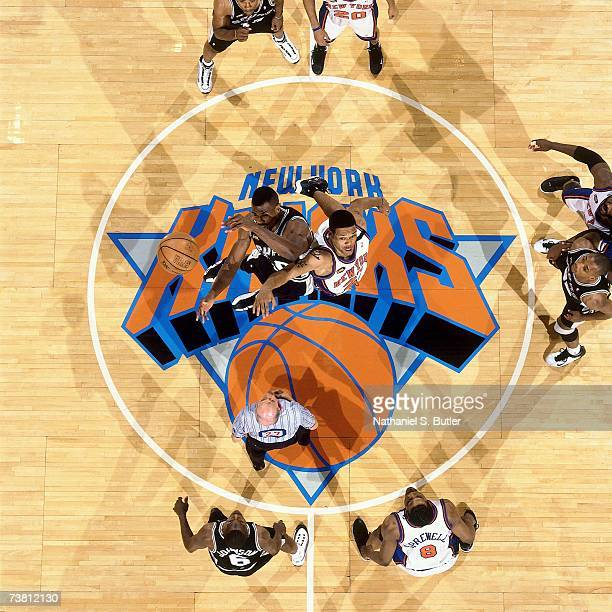 Patrick Ewing of the New York Knicks battles David Robinson of the San Antonio Spurs for the opening tipoff in Game Five of the 1999 NBA Finals on...