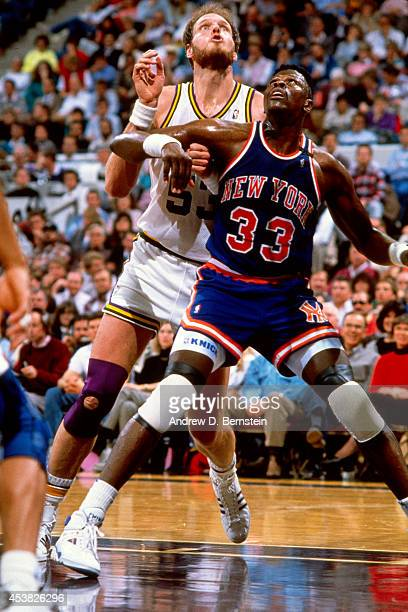 Patrick Ewing of the New York Knicks boxes out against Mark Eaton of the Utah Jazz circa 1990 at the Salt Palace in Salt Lake City Utah NOTE TO USER...