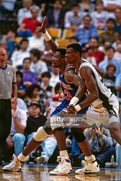 Patrick Ewing of the New York Knicks calls for the ball while guarded by David Robinson of the San Antonio Spurs at HemisFair Arena in San Antonio...