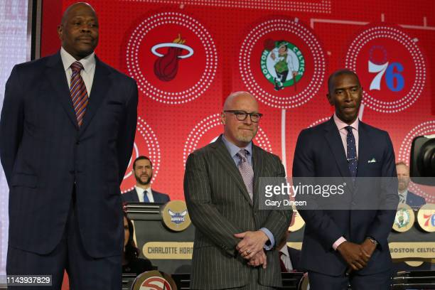 Patrick Ewing of the New York Knicks David Griffin of the New Orleans Pelicans and Elliot Perry of the Memphis Grizzlies pose for a photo on stage at...