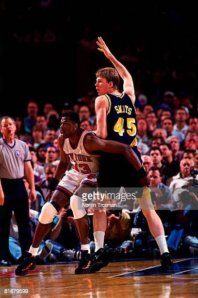 Patrick Ewing of the New York Knicks defends against Rick Smits of the Indiana Pacers in Game One of the Eastern Conference Semifinals during the...