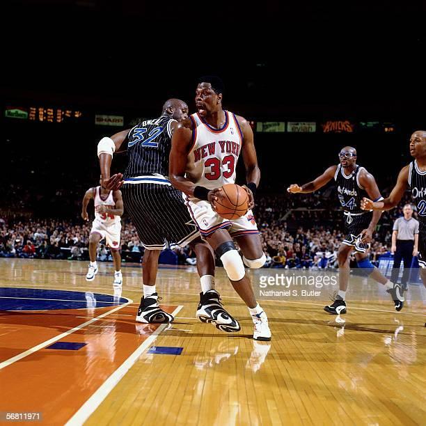 Patrick Ewing of the New York Knicks dribbles against Shaquille O'Neal of the Orlando on February 1 1996 at Madison Square Garden in New York New...