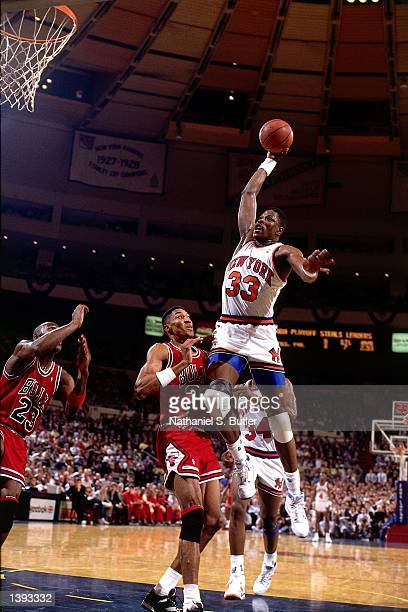 Patrick Ewing of the New York Knicks drives to the basket against Scottie Pippen of the Chicago Bulls during the 1989 NBA Playoffs at Madison Square...