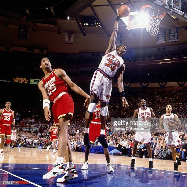 Patrick Ewing of the New York Knicks dunks against Robert Horry of the Houston Rockets during Game Five of the NBA Finals played on June 17 1994 at...