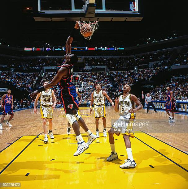 Patrick Ewing of the New York Knicks dunks against the Indiana Pacers on December 25 1999 at Conseco Fieldhouse in Indianapolis Indiana NOTE TO USER...